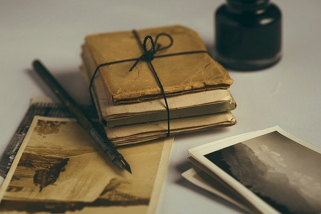 old letters, quill, old photos